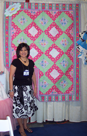 Phyllis Dobbs with a quilt made of Sweetheart Ballerina Fabirc