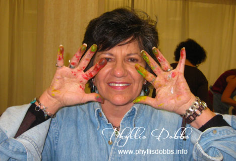 Phyllis Dobbs' hands covered with paint