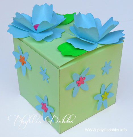 Giftbox decorated with flowers and paint