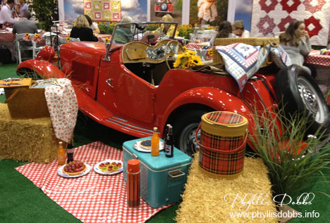 Red MG car in Michael Miller Booth at Quilt Market