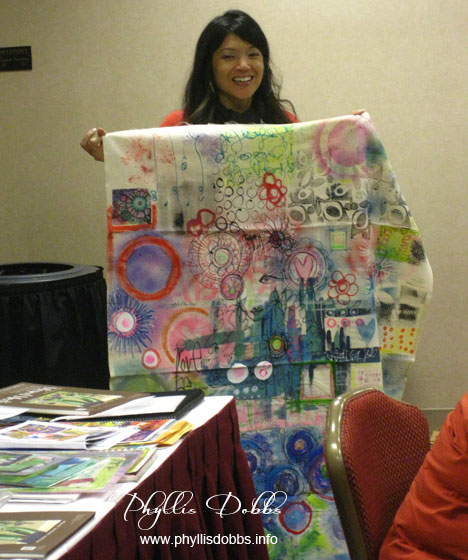 Traci Bautista showing art journaling on fabric