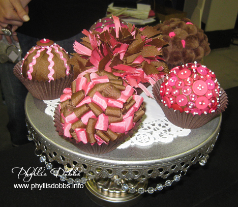 Delicious looking ribbon cupcakes by Ribbon Ring for the CHA show