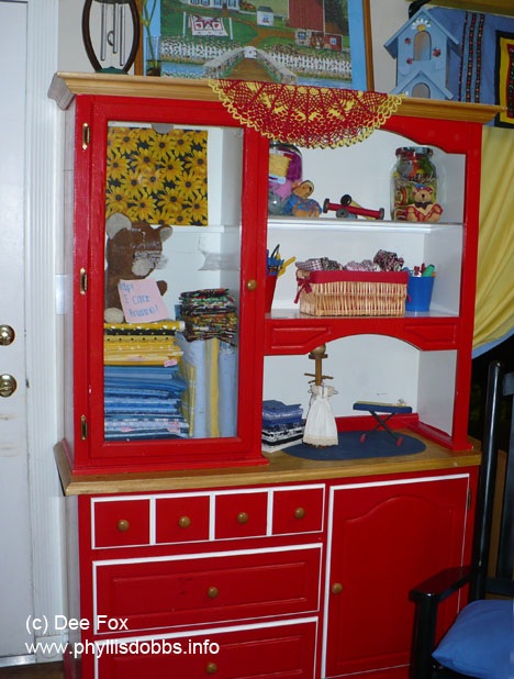 Red storage cabinet for sewing supplies