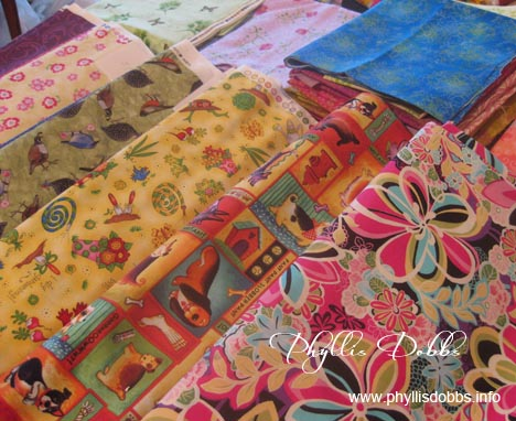 Stack of fabrics for Quilt book