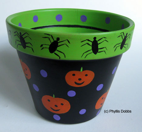 Flower Pot Painting Designs http://phyllisdobbs.info/2008/10/07/trick-or-treat-paint-this-terra-cotta-pot-to-serve-candy-for-your-trick-or-treaters/