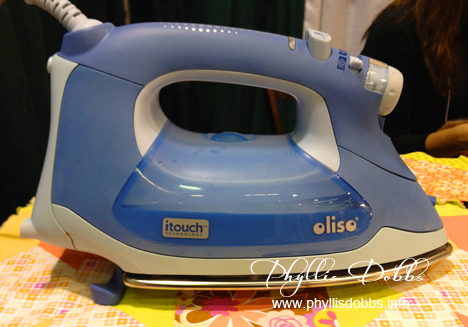 Oliso smart iron in use at CHA